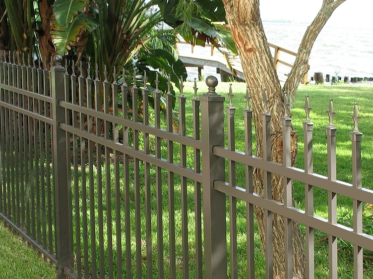 aluminum fencing in a back yard.
